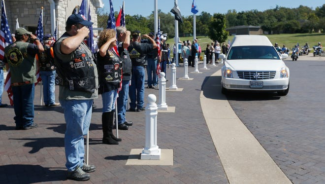 Members of the Patriot Guard Riders salute as the funeral procession for retired Marine Richard William Bailey Jr. arrives at the Missouri Veterans Cemetery on Monday, September 12, 2016.
