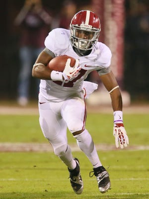 Alabama Crimson Tide running back Kenyan Drake (17) advances the ball during the game against the Mississippi State Bulldogs at Davis Wade Stadium.