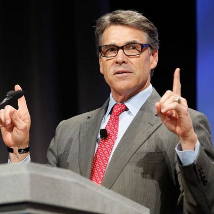 DALLAS, TX - AUGUST 29: Texas Governor Rick Perry speaks at the Defending the American Dream Summit sponsored by Americans For Prosperity at the Omni Hotel on August 29, 2014 in Dallas, Texas. Included to speak at the eighth annual summit are U.S. Senators Rand Paul and Ted Cruz as the summit will run until August 30th. (Photo by Mike Stone/Getty Images)