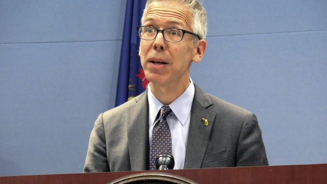 FILE - In this June 26, 2019 file photo, Robert Gordon, director of the Michigan Department of Health and Human Services, speaks at a news conference in Lansing, Mich. Under Michigan's health code, Gordon has the ability to install emergency orders to curtail the spread of disease.