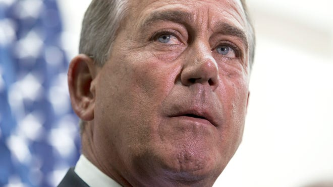 House Speaker John Boehner of Ohio participates in a news conference on Capitol Hill in Washington, Wednesday, July 9, 2014. Boehner addressed questions on a $3.7 billion request for emergency funds to secure the U.S. and Mexican border. (AP Photo/ Evan Vucci)