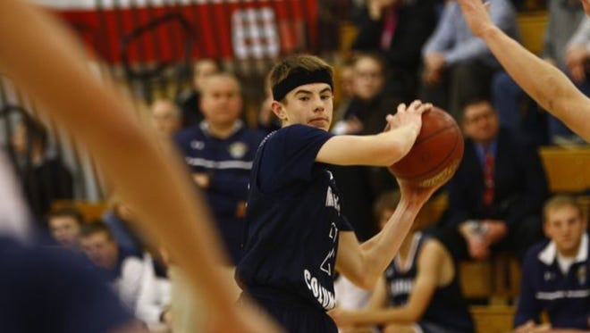 Nick Malovrh and the Columbus Catholic boys basketball team moved up a spot to No. 1 in Division 5 in this week's Associated Press state basketball poll.