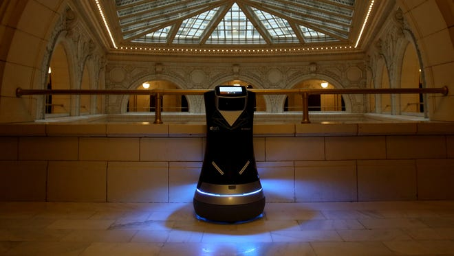 Aloft Hotels has taken Botlr, an automated robot, on the road to show off the robot that is already operational in two Aloft hotel properties in northern California. The Botlr visited the David Whitney building in Detroit, the home of the Aloft Detroit. The robot will deliver items from water, towels, extra soap or snacks to guests who call for it from their room phone. Using Bluetooth equipped elevators, Botlr can make its way to various floors using sensors in the front to steer itself to the front door of  a guest's hotel room.