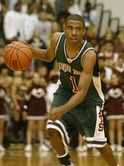 Lawrence North's Mike Conley, shown as a sophomore, was Greg Oden's sidekick for three state championships. He's the Memphis Grizzlies' point guard.