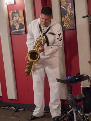Navy Petty Officer 2nd Class Owen Sczerba of Poughkeepsie performs a solo during a live radio broadcast in a KNKX studio during Seattle's 68th annual Seafair Fleet Week, which was held the first week of August.
