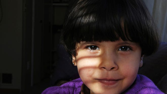 Rimas Marie Alhamoud, 4, poses for a portrait in her home in Hamilton County Friday, November 13, 2015. After her family escaped Homs, Syria, the city was destroyed. The Enquirer/Meg Vogel