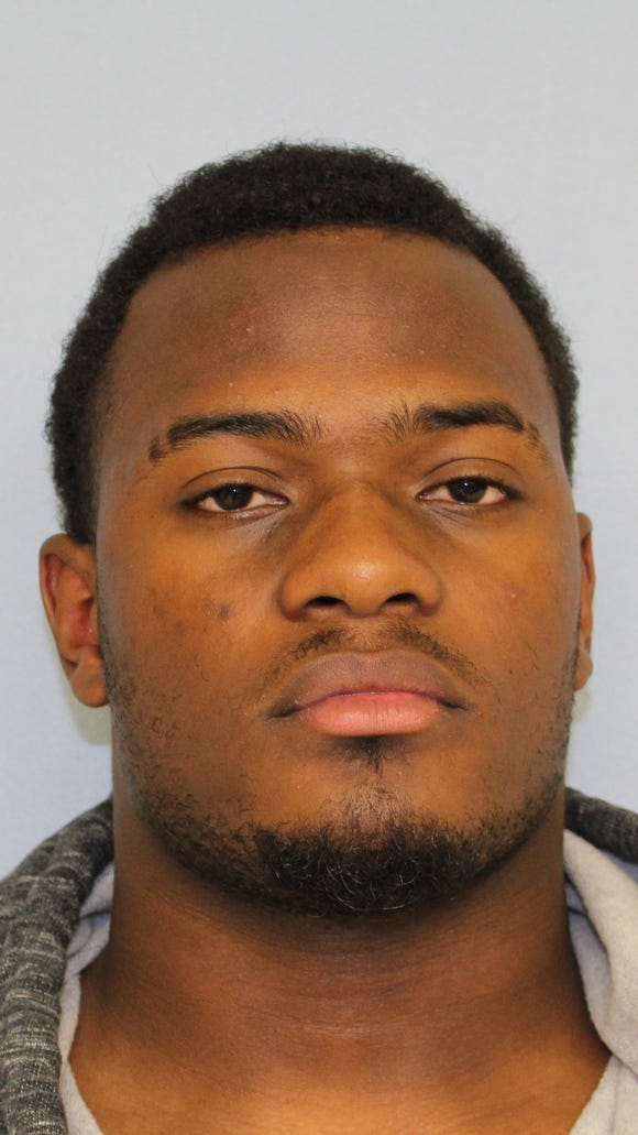 Auburn defensive end Elijah Daniel was arrested on theft and burglary charges.