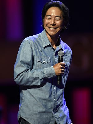 Comedian Henry Cho performs at the Grand Ole Opry Tuesday Sept. 15, 2015, in Nashville, Tenn.
