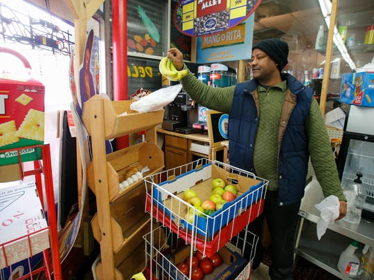 Soloman Woldrufle, owner of JohnnyÕs Store in East Walnut Hills, shows where he places fresh produce in his store, Tuesday, March 7, 2017, in Cincinnati.
