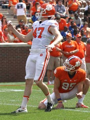 Clemson kicker Alex Spence (47) kicks an extra point