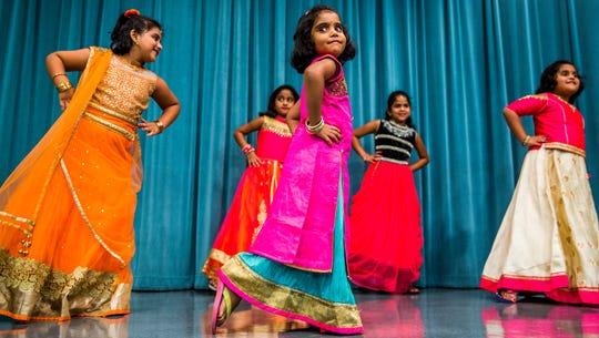 From left, Darshika Magesh, 6, Aanya Potluru, 6, Jashitha