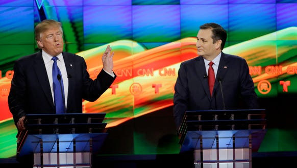 Donald Trump speaks as Ted Cruz looks on during the