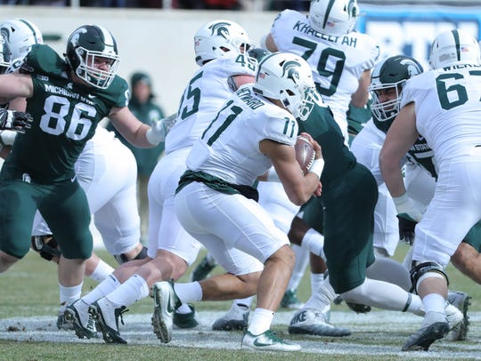 Michigan State running back Connor Heyward runs the