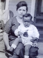 A young Mitchell Spellman sits on the lap of his mother, Altonette, around 1924 or 1925.