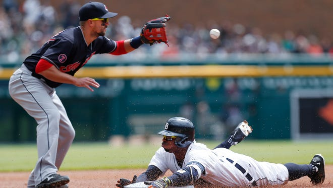 Detroit Tigers outfielder Rajai Davis, right, slides safely into third base for a triple against the Cleveland Indians on Sunday, April 26, 2015.