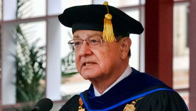 In this May 12, 2017, photo, USC President C.L. Max Nikias presides at commencement ceremonies on the campus in Los Angeles.