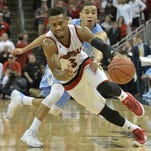 Feb 1, 2016; Louisville, KY, USA; Louisville Cardinals guard Trey Lewis (3) dribbles against North Carolina Tar Heels guard Marcus Paige (5) during the second half at KFC Yum! Center. Louisville defeated North Carolina 71-65. Mandatory Credit: Jamie Rhodes-USA TODAY Sports