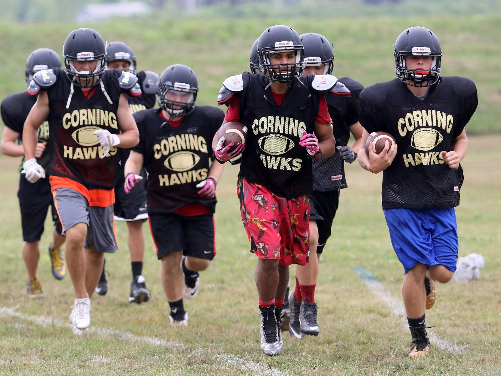 Corning-Painted Post football players run together during a preseason practice.
