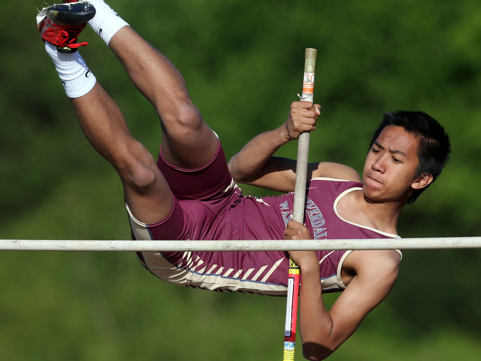 Riverdale's Bryan Abriol competes in the pole vault Monday. Abriol finished fourth, clearing 8 feet.