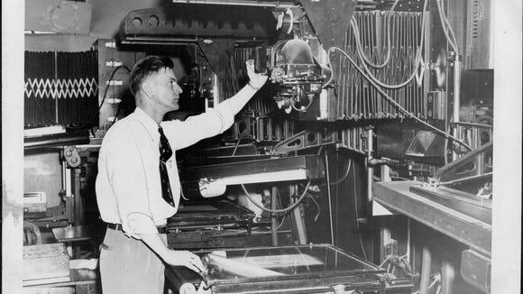 A Monroe County Clerk's supervisor, Norman Kindler, makes a photostat (photocopy) of a document from microfilm, circa 1951.