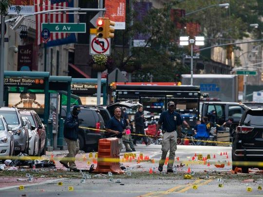 In this Sept. 18, 2016 file photo, crime scene investigators work the scene of a pressure cooker bomb explosion in Manhattan's Chelsea neighborhood, in New York.
