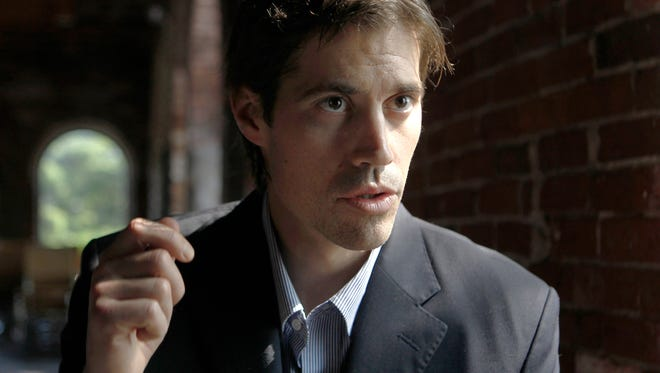 Journalist James Foley, of Rochester, N.H., responds to questions during an interview with the Associated Press in Boston on May 27, 2011.