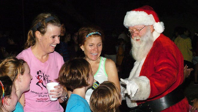 Santa Claus mingled with crowd during a previous Islander Lights Celebration.