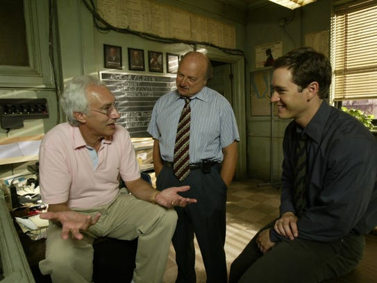 "Steven Bochco, left, talks with his ""NYPD Blue"" stars"