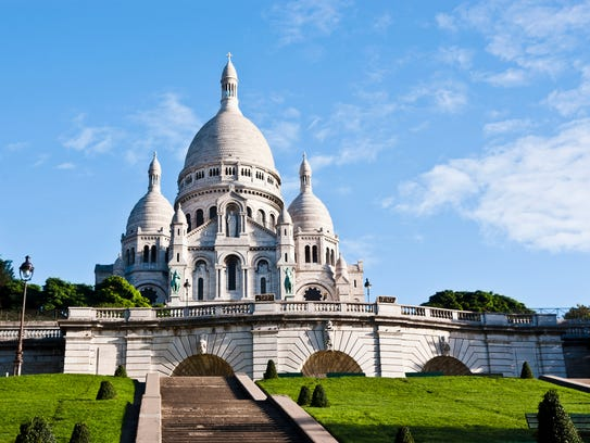 The Basilica of Sacre Coeur in Montmartre, Paris. Converted