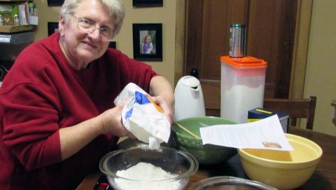 Susan weighs 440 grams of flour (3 cups) for sourdough bread.