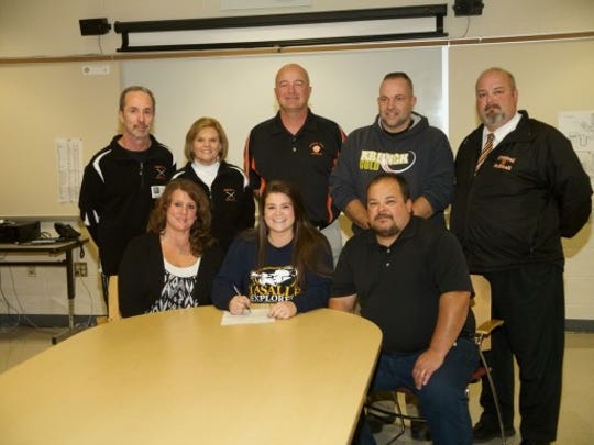 Pictured are, seated from left, Missy Rohbraugh, Taylor Rohrbaugh and Rich Rohrbaugh; standing, from left, former coaches Barry and Deb Brenneman, Athletic Director Marty Trimmer, travel coach Steve Mumma and high school softball coach Shane Walker. (SUBMITTED)
