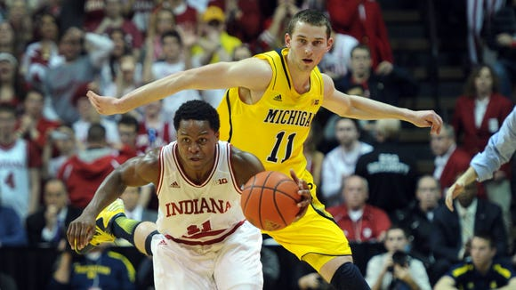 Nik Stauskas (11) was a role player for Michigan last season, but the sophomore has turned into one of the Big Ten's best players in 2014.