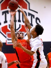 Blackman's Trent Gibson (33) goes up for a shot as