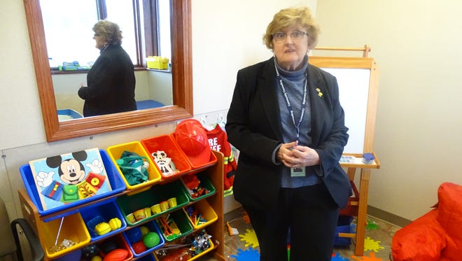 Margaret Ostrowski, a licensed counselor, explains the purpose of each toy used during play therapy sessions at Crawford County Community Counseling.