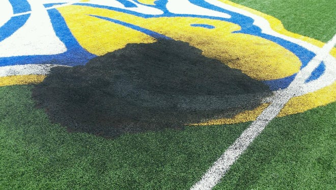 School officials discovered a burn mark on the artificial turf athletic field behind Irondequoit High School on July 24, 2017. It was not immediately known what caused the damage.