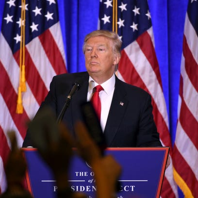President-elect Donald Trump answers journalists questions