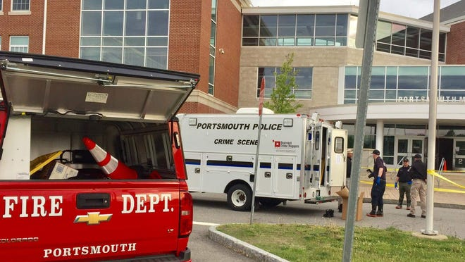Authorities investigate May 23 at Portsmouth Middle School, where a fire was intentionally set.