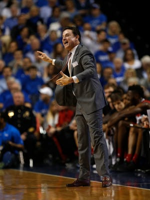 Louisville Cardinals head coach Rick Pitino react during the first half against the Kentucky Wildcats at Rupp Arena.