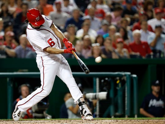 FILE - In this Sept. 6, 2016, file photo, Washington Nationals' Anthony Rendon hits a grand slam during the third inning of a baseball game against the Atlanta Braves at Nationals Park, in Washington. Boston Red Sox pitcher Rick Porcello has won the AL Comeback Player of the Year award, while Washington Nationals third baseman Anthony Rendon received the NL honor, Tuesday, Nov. 29, 2016. (AP Photo/Alex Brandon, File)