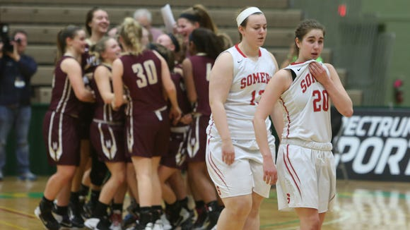 Somers players walk off the court after they were defeated by Pittsford Mendon, 53-41, in the girls Class A state semifinal  game at Hudson Valley Community College in Troy March 17, 2017.
