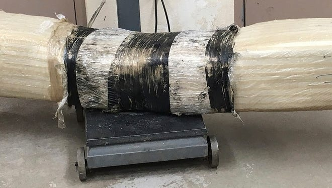 This undated photo provided by Customs and Border Protection shows a 100-pound bundle of marijuana. Border Patrol agents in southern Arizona have seized nearly 100 pounds of marijuana after spotting it flying over the border fence.