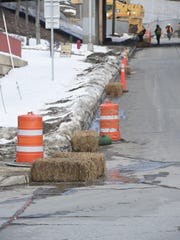 A view of some hay bales on Fox Street being used to contain mud from running off into the sewers from the construction area at Vassar Brothers Medical Center in the City of Poughkeepsie.