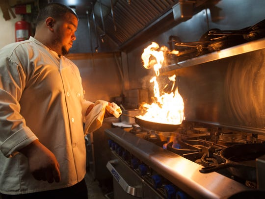 Chef Oliver Munguia works in the kitchen of Keg & Kitchen