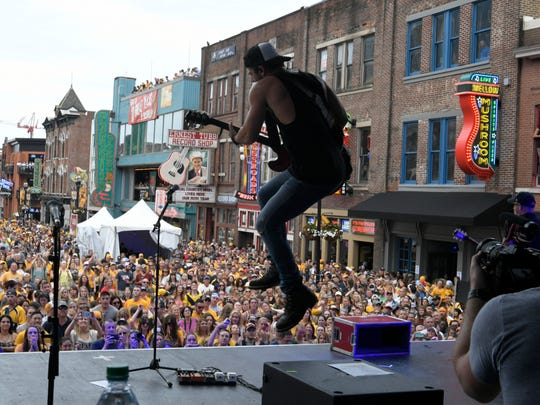 Kip Moore performs on Lower Broadway before Stanley Cup Final Game 4 on Monday, June 5, 2017, in Nashville, Tenn.