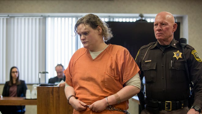 Elizabeth Long is led out of the courtroom after sentencing Thursday, April 14, 2016 at the St. Clair County Courthouse in Port Huron. Elizabeth Long was sentenced to 22 to 50 years in prison for second-degree murder and second-degree child abuse in the death of her 16-month-old son, Lukas.
