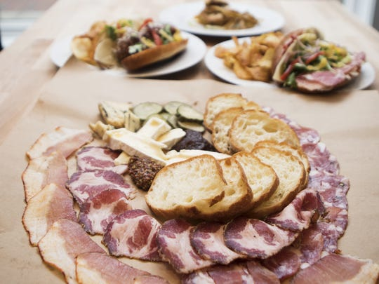 Panino's house made salami and charcuterie board, which serves three to four, is duck prosciutto, soppressata, coppa, paired with three local cheeses, local honey, house pickles, mustard and artisan bread ($30).