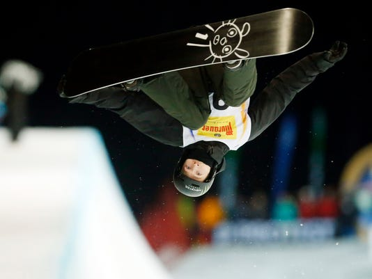 FILE - In this Jan. 17, 2015, file photo, Switzerland's Iouri Podladtchikov competes to place fourth at the snowboard halfpipe final at the Freestyle Ski and Snowboard World Championships in Kreischberg, Austria. Defending halfpipe champion Podladtchikov has arrived in Pyeongchang, though his status for next week's contest remains day-to-day.  Podladtchikov, known as the I-Pod, broke his nose in a nasty fall at the Winter X Games on Jan 28, 2018. He was taken off the mountain on a stretcher and admitted to the hospital, but scans for brain and neck injuries came back negative. He is expected to go to the mountain, but a spokesperson for the Swiss team says he'll decide day-to-day whether he is going to ride.  (AP Photo/Darko Bandic, File)