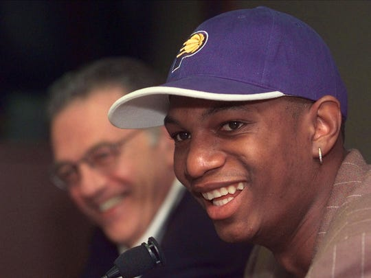 FILE - Pacers president Donnie Walsh, left, laughs as Jonathan Bender talks at his introductory news conference in Indianapolis, Aug. 4, 1999.