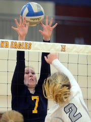 Hartland's Dayna Schaefer goes up to block a shot by South Lyon East's Brooke Schmidt in a Class A district volleyball match on Monday.