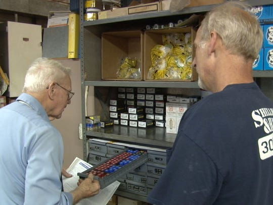 Ralph Lashley (left) fills out a purchase order at